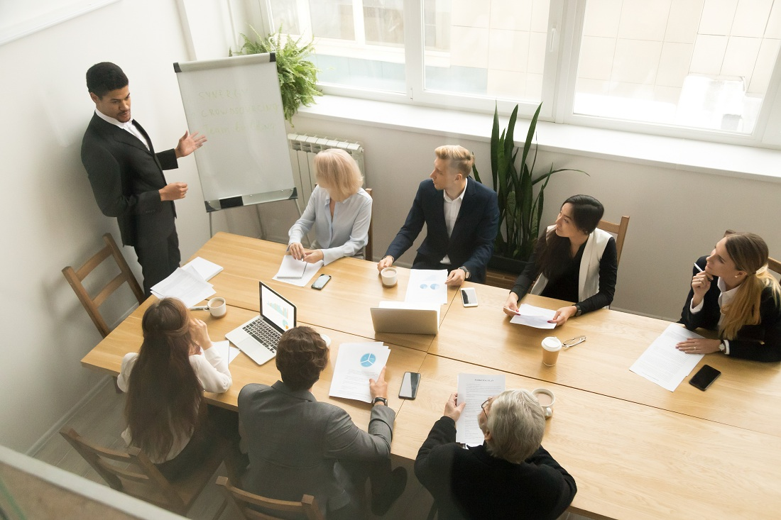 man giving presentation at corporate team meeting