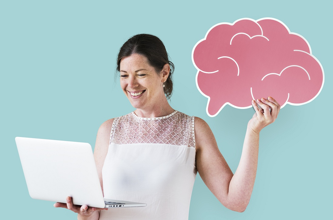 woman holding brain icon using laptop